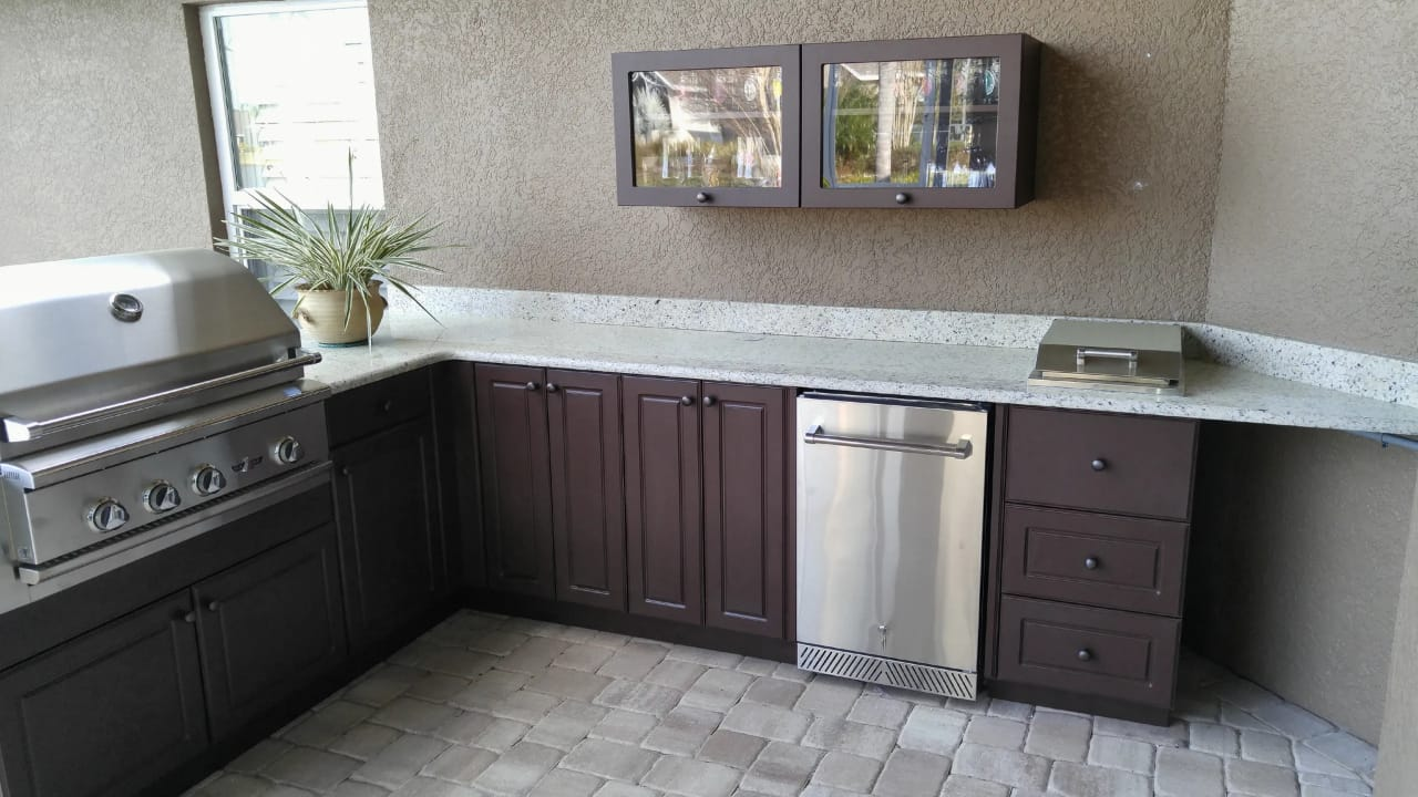 great outdoor kitchen with above counter display cabinets